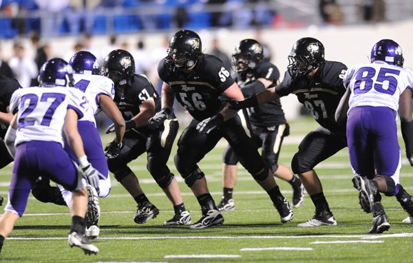 bentonville-offensive-lineman-marcus-danenhauer-center-prepares-to-block-against-the-fayetteville-defensive-line-in-the-first-half-of-the-class-7a-state-championship-game-on-dec-3-in-war-memorial-stadium-in-little-rock