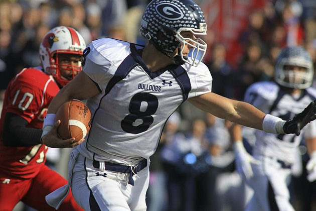 greenwood-quarterback-stephen-hogan-shakes-off-a-tackle-in-the-class-5a-state-championship-game-at-war-memorial-stadium-in-2010-the-bulldogs-which-have-won-four-state-football-titles-since-2005-will-move-to-class-6a