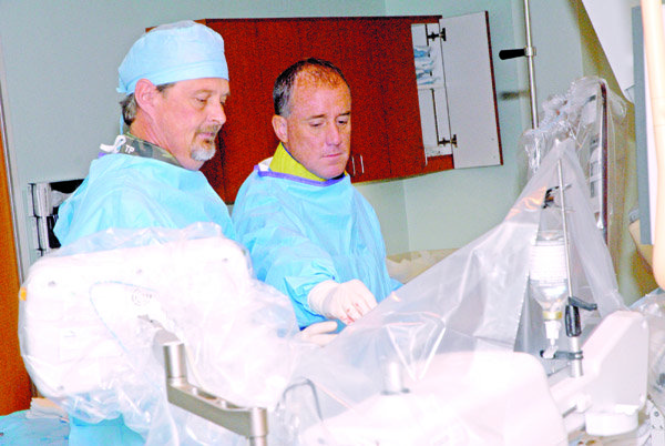 tom-pelton-and-dr-jeffery-tauth-perform-a-cardiac-catheterization-procedure-in-the-heart-and-vascular-center-at-st-josephs-mercy-health-center-in-hot-springs