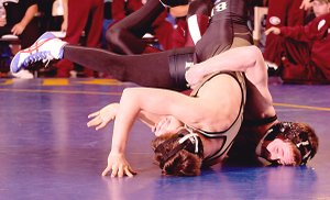Gentry's Kolby Rankin, right, tries to pin Bentonville's Austin Gonzalez during the Northwest Arkansas Duel wrestling meet Friday Dec. 10, 2010 at Har-Ber High School in Springdale.