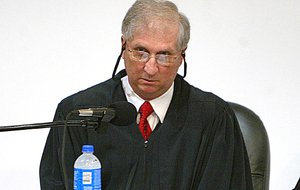 Arkansas Supreme Court Justice Paul Danielson gets ready to hear oral arguments on a case involving the city of Hot Springs' wastewater fees Thursday, April 30, 2009, at the Roy Rowe Auditorium.
