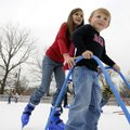 Claire O'Dell, 9, of Bentonville helps her friend Brooks Burleson, 4, of Rogers ice skate Tuesday du...