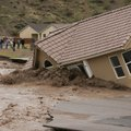 A house in the Beaver Dam Resort area falls into the Beaver Dam Wash in Beaver Dam, Ariz. Tuesday, D...