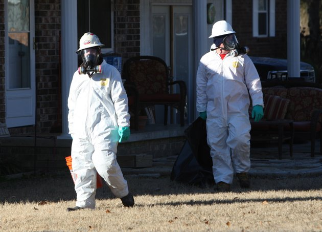 workers-with-united-states-environmental-services-llc-don-protective-gear-as-they-pick-up-dead-birds-along-leewood-cove-on-sunday-morning-in-beebe