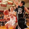 Farmington senior guard Chase Leichner, left, attempts to score as Pea Ridge sophomore Joe Adams def...