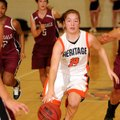 Rogers Heritage guard Ashley Ward drives to the basket against Springdale High on Jan. 18 in War Eag...