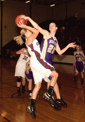 Gentry sophomore Tara Arnold attempts a shot under the basket Friday against a Berryville defender.