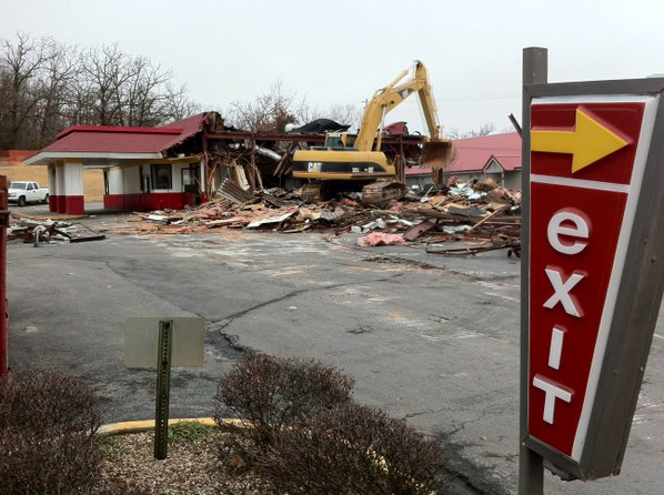 Construction workers demolish the McDonalds ...