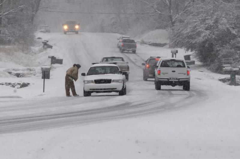 In Northwest Arkansas, snow shuts schools, hampers travel