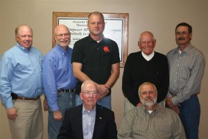The Gravette Board of Education is an elected group of seven members. John Edwards (front, left) and board president Marion Harris, Jim Singleton (back, left), vice president Dan Yates, Jim Hendren, Jack Skillett and Danny Alsup.