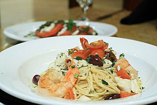 linguine-pescatore-featuring-shrimp-crab-fish-capers-tomatoes-and-olives-in-a-white-wine-butter-sauce-2295-is-a-pasta-selection-at-capriccio-grill