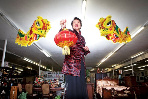 sue-khoo-stands-between-two-dragon-kites-in-her-store-unique-furniture-in-jacksonville-khoo-is-organizing-a-chinese-lantern-festival-that-will-feature-fun-food-and-the-talents-of-the-university-of-central-arkansas-confucius-institute-for-arkansas-the-festival-will-be-held-saturday-feb-19-in-jacksonville