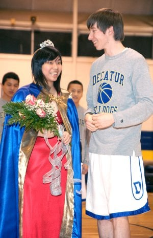 Decatur High School Colors Day Queen Chai (Shelly) I-Hsuan smiles alongside captain Mitchell Nelson.