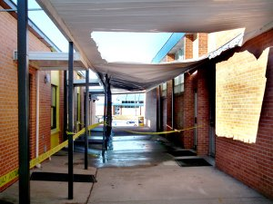 Heavy snow last week caused the awning over the walkway between the Decatur High School administration building and cafeteria to sag dangerously. Part of the awning was cut away so the snow could melt away in a controlled manner without doing any more damage. Yellow caution tape kept students away when school resumed on Monday.