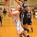 Bentonville's McKinzie James shoots a layup as Fayetteville's Brittany Austin attempts to block the ...