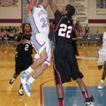 Springdale High's Dashaun Stark attempts to block the shot of Fort Smith Southside's Daren Harris on...