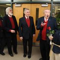 Rob Sabata, from left, Brian Scott, Bryce Hopkins and Ed Downey deliver a singing valentine to Sprin...