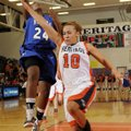 Rogers High's Taylor Strickland, left, scores on a layup off a steal as Rogers Heritage's Yalile Joh...
