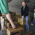 SWEET ARRIVAL Haley Holstein, center, loads a pallet of Girl Scout cookies Friday delivered to the S...