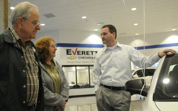 Jimmy Young, From Right, General Manager Of The Everett Cheverolet, Talks  With Teresa Abshier And Her Husband, Ron Abshier, As They Shop For A Car  Thursday ...