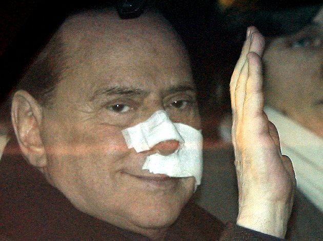 this-dec-17-2009-file-photo-shows-italian-premier-silvio-berlusconi-waving-from-his-car-as-he-arrives-at-his-home-in-arcore-italy-after-being-attacked-by-a-mentally-ill-man-at-a-political-rally