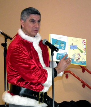 Superintendent Larry Ben, dressed as the Grinch, read a Dr. Seuss book to Decatur Northside Elementary students at a school assembly on Wednesday. Ben greeted children with a Grinch mask, but had to take his mask off to read the story.