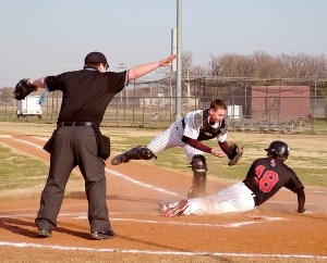 Pulled away from the plate by the throw, Gentry catcher Kolby Rankin can't get a quick enough tag on a Pea Ridge base runner during play in Gentry on Friday.