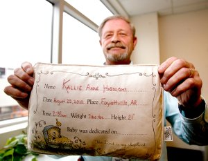 Terry Franklin, director of finance and properties at Northwest Arkansas Regional Airport, recently connected with the Hignight family in Summers after airport employee Bill Schoepf found a pillow bearing a girl's name and birth information on XNA grounds.
