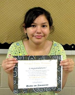 Cassandra Guerra holds a certificate she was awarded for her winning logo design for the City of Gravette. She also received a cash award from the Bank of Gravett.