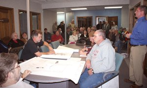 There was standing room only at the Monday night meeting of the Gravette Planning and Zoning Commission when it took up plans related to a new Walmart store on the south side of the city.