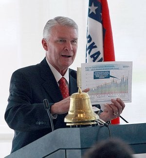 James Lee Witt, former director of the Federal Emergency Management Agency during President Bill Clinton's term, uses a chart of the most costly disasters since 1980 to illustrate points he was making during a lecture March 16, 2011, at the Clinton Presidential Center in Little Rock.