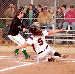 Gentry junior Cloie Sikes slides across the plate well ahead of the throw from Greenland's catcher in the March 11 rescheduled game at Gentry.
