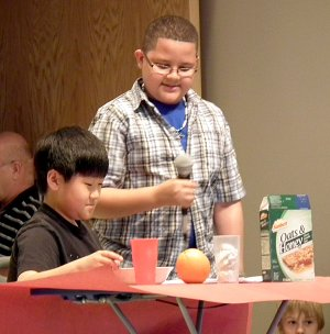 """Sterling Yang and Jordan Johnson acted out the importance of eating a healthy breakfast in a skit titled """"The Angry Stomach"""" during Monday's pep rally at the Decatur Northside Elementary School. The pep rally was held to get students ready for the """"big test"""" and included two skits, songs and cheers."""