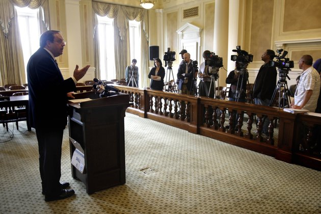 arkansas-family-council-president-jerry-cox-left-speaks-to-reporters-at-the-arkansas-state-capitol-in-little-rock-after-the-state-supreme-court-struck-down-an-arkansas-law-prohibiting-gay-couples-and-other-unmarried-people-who-live-together-from-adopting-or-serving-as-foster-parents