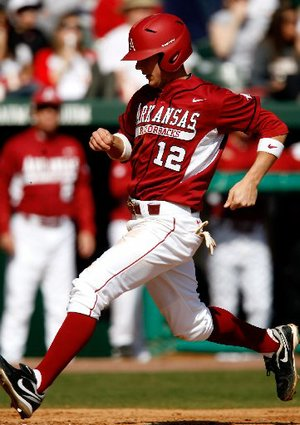 Bo Bigham scored on a sacrifice fly in the ninth inning Sunday, giving Arkansas a 5-4 win over LSU. The Razorbacks swept the three-game series.