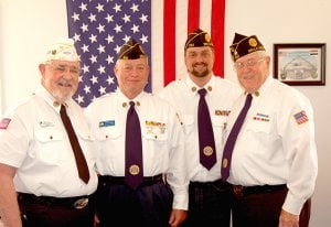 Bella Vista American Legion Post members Norvil Lantz (left), Lewis Kaslow, Chris Cole and post commander Jake Greeling posed for a photo in front of the U.S. Flag at their recent post meeting.