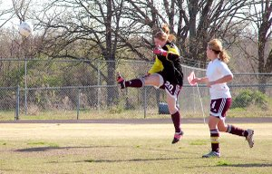 Gentry's goal keeper, Terra Jones, kicks one away during the team's April 5 game against Fayetteville. The girls lost 7-0 in the match up. Ashley Scott was there to help protect Gentry's goal.