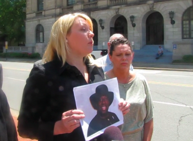 attorney-jessica-d-arbour-left-holds-up-a-photo-of-catholic-priest-charles-u-kanu-during-a-news-conference-wednesday-outside-the-pulaski-county-courthouse