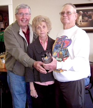 Gene and Norma Wilmoth, left, receive an award April 4 from Chamber of Commerce president Royce Johnson for their lifetime of service in the Decatur community.