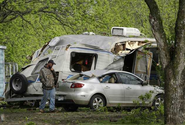donnie-spires-walks-near-a-recreational-vehicle-near-scott-on-friday-april-15-2011-where-a-56-year-old-man-was-killed-when-the-rv-collapsed-on-him-during-a-severe-storm