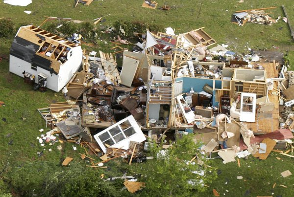 a-house-lies-destroyed-in-vilonia-ark-tuesday-april-26-2011-after-a-tornado-hit-the-area-late-monday-more-severe-weather-and-possible-tornadoes-struck-arkansas-tuesday-night-while-residents-across-the-state-cleaned-up-from-mondays-storms