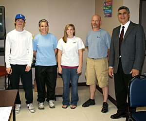 Mitchell Perry, Sienna Shaw and Brittany Booth are pictured with coach Donnie Smith and superintendent Larry Ben.