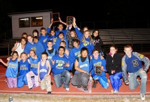 The Decatur Junior High track teams posed with their trophies after the boys' team won the conference championship held in Eureka Springs on April 20. The girls' team won second place in the competition, finishing only 10 points behind the champions. Trey Kell, a member of the Decatur boys' team, also took the title of conference most valuable player at the meet.