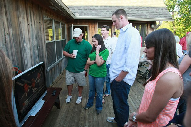 former-arkansas-quarterback-ryan-mallett-second-from-right-watches-the-nfl-draft-preview-show-at-a-hunting-lodge-near-stuttgart-on-thursday