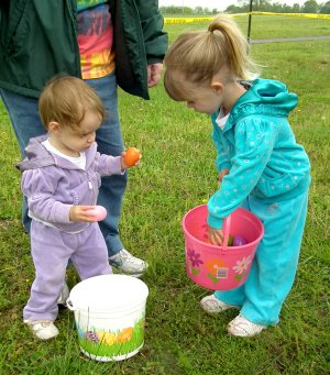 Sisters Emma and Mekena Dalke, ages 1 and 2, shared eggs after the Decatur Chamber of Commerce Egg Hunt held in Veteran's Park on Saturday morning.