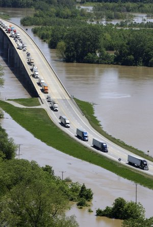Heavy traffic crosses the White River on a bridge near Augusta, Ark., after the westbound lanes of Interstate 40, about 30 miles south, were closed Thursday, May 5, 2011 due to high water.