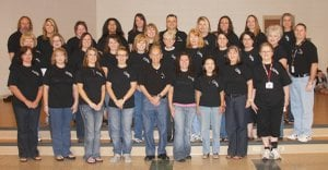 Gentry Primary School teachers and staff pose for a picture during teacher appreciation week. Everyone in the building received a GPS T-shirt, courtesy of Vinyl Visions.