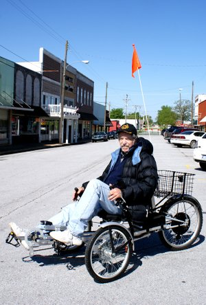 "Don Justice and his three-wheel ""Eco-bike"" on Gravette Main Street."
