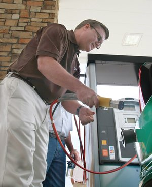 Arkansas Democrat-Gazette/RICK MCFARLAND - 05/13/11- Walter Bryant, president of Region 1 for CenterPoint Energy, finishes filling  the first car to use the Southwestern Energy natural gas station in Damascus Friday.