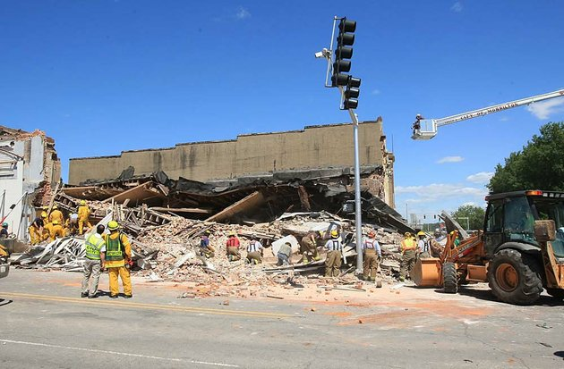 emergency-personnel-begin-the-process-of-searching-through-debris-from-a-collapsed-building-at-the-corner-of-broadway-and-division-streets-in-downtown-morrillton